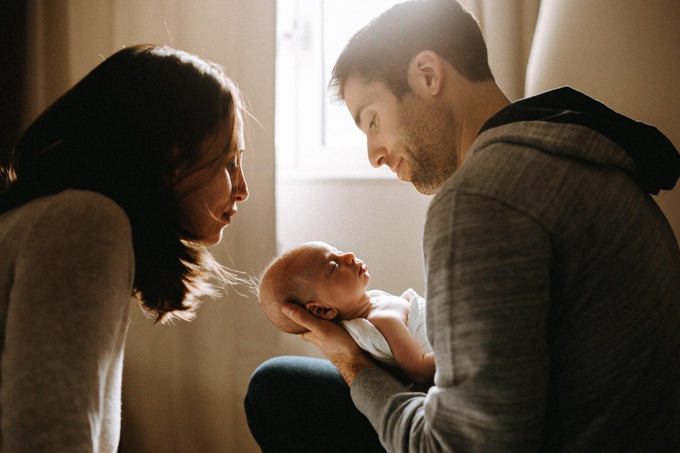 parents looking over newborn