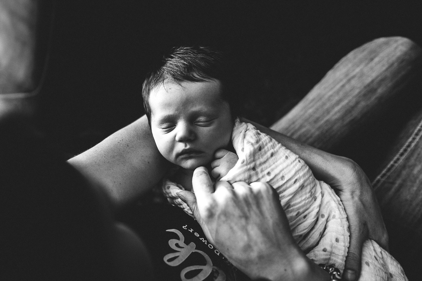 newborn baby in moms arms