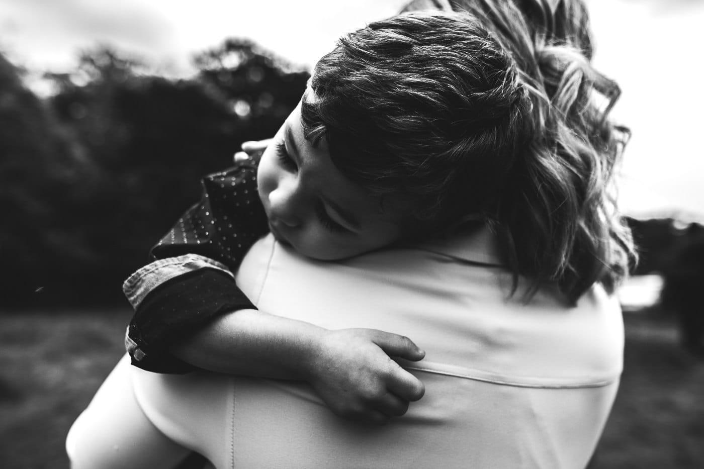 boy hugging his mom