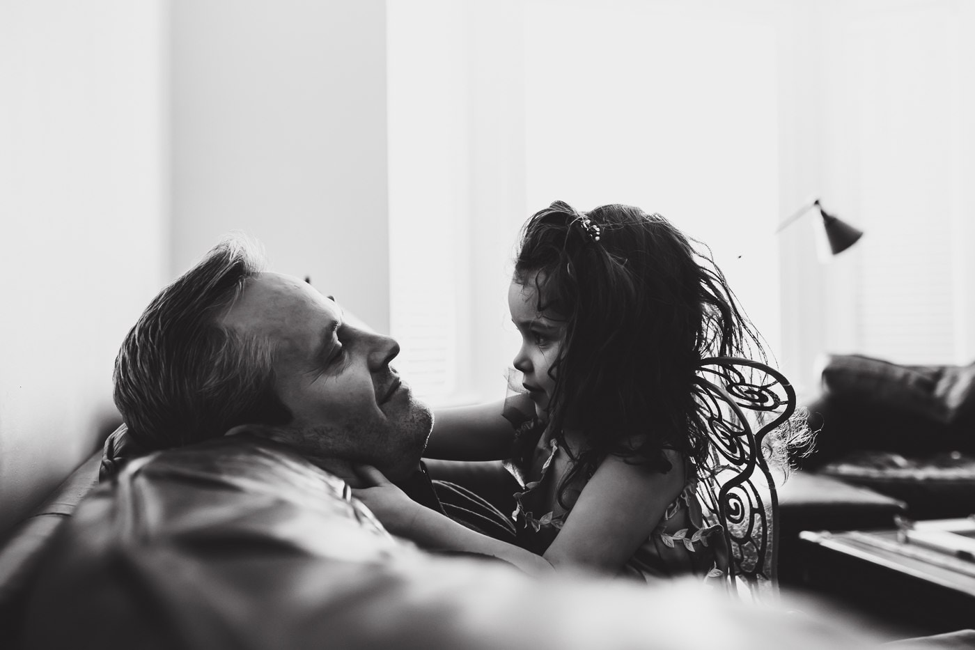 girl and dad smiling at each other
