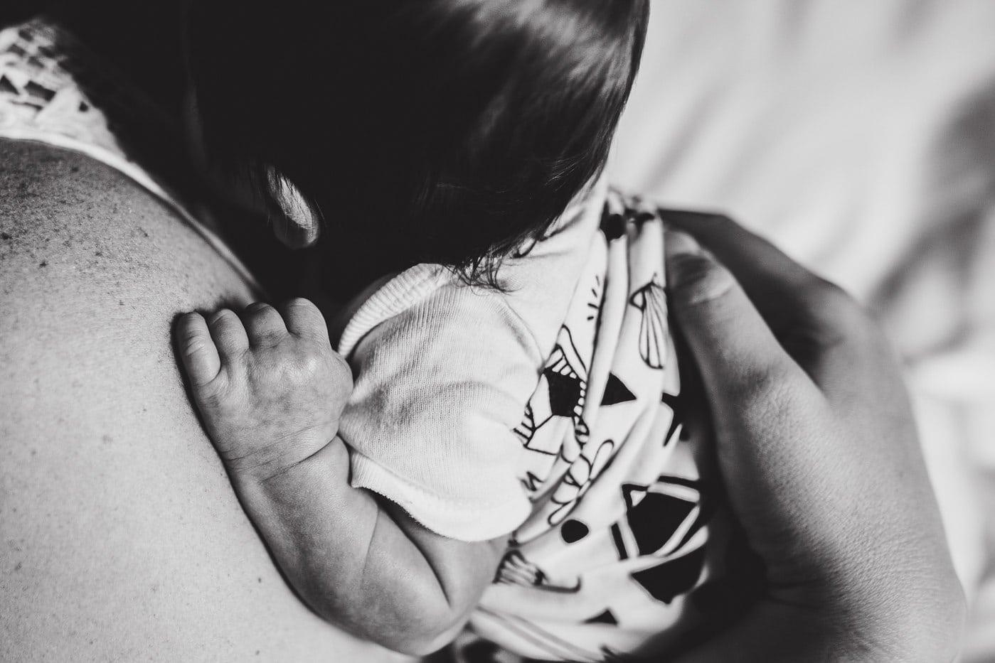 closeup newborn on moms chest