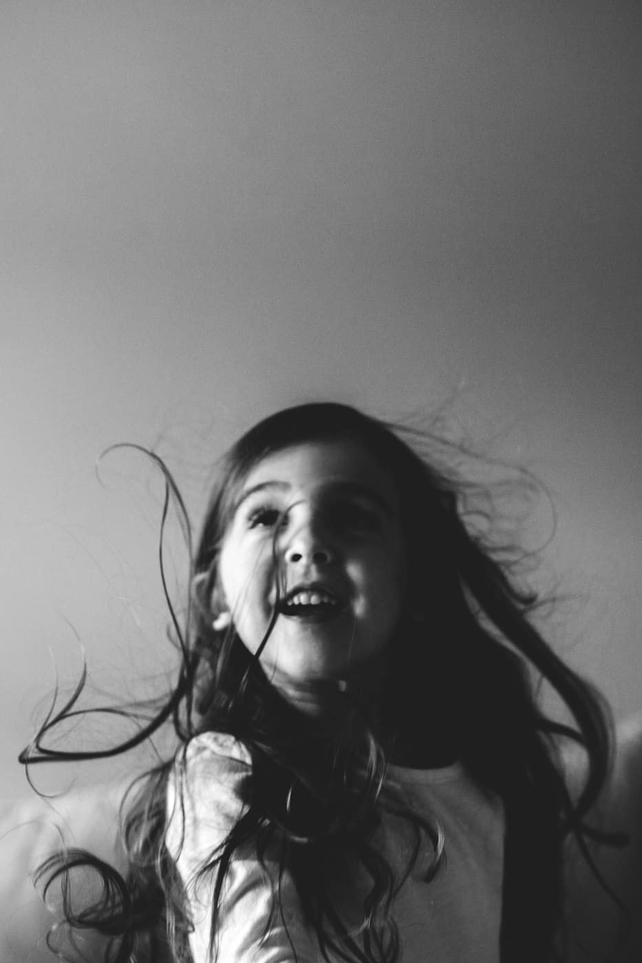 black and white picture of girl playing in her house